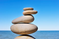 Balance and Equilibrium. Some of white flat pebbles built one after another Stock Photos