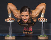 Balance and Flexibility:  Female Fitness Athlete. Sporty, athletic beauty Paige Tarloski demonstrates balance, flexibility, strength, and poise as she competes Royalty Free Stock Photos