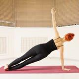 Balance on hand yoga pose Stock Photo