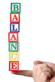Balance on haned. Business people holding balance word on white background royalty free stock photo