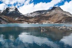 Balance and harmony: Stone stacks and Sacred Lake near Gokyo. In Himalayas Stock Photo