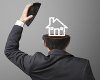 Balance on job or family concept house drawing by cloud inside b. Usinessman head on gray background Stock Image