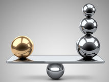 Balance between large gold and steel spheres. Stock Photos