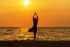 Balance meditation yoga spirit lifestyle mind woman peace vitality, silhouette outdoors on the Sea sunrise, royalty free stock photos