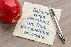 Balance is not something you find. It`s something you create - handwriting on a napkin with a red apple Royalty Free Stock Photos