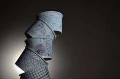 The Balance. The Paper Cups try to reach their destiny by their balance Royalty Free Stock Image