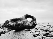 Balance of pebbles against the background of blurred sea.  Smooth atmosphere on beach Stock Photography