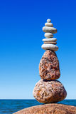 Balance and poise stones against the sea. Rock zen on the background of blue sky Royalty Free Stock Photography