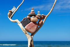 Balance and poise stones. Rock zen on the background of blue sky and sea.  royalty free stock photography