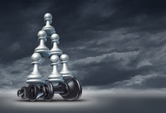 Balance Of Power. And team victory as a business strategy chess symbol of changing the leader by teaming up in partnership and collaborating together to defeat Royalty Free Stock Images