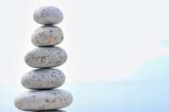 Balance prime. Stacked stones on a background of sky Stock Photo