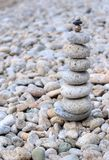 Balance prime. Stacked stones on a seashore Stock Image