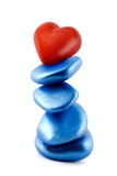 Balance red heart in stone Royalty Free Stock Images