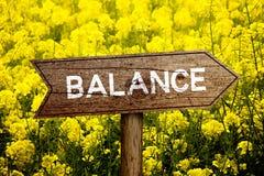 Balance roadsign. Balance wooden roadsign with beautiful natural background Stock Photos