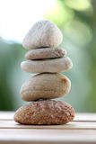 Balance rock or zen stones on wooden floor and have nature green Stock Images