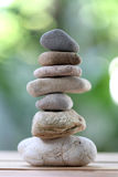 Balance rock or zen stones on wooden floor and have nature green Royalty Free Stock Photography