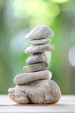 Balance rock or zen stones on wooden floor and have nature green Royalty Free Stock Photo