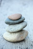 Balance rocks on wood table Royalty Free Stock Photography