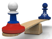 The balance between the Russian Federation and NATO. Concept. Chess pieces - pawns in the colors of the flags of the Russian Federation and North Atlantic Treaty Stock Photo