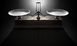 Balance Scale Comparison. A closeup of empty old metal and wood two pan balance scale on a dramatic dark background - 3D Render Royalty Free Stock Photography