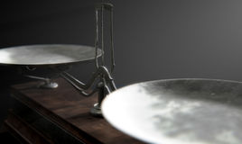 Balance Scale Comparison. A closeup of empty old metal and wood two pan balance scale on a dramatic dark background - 3D Render Stock Photo