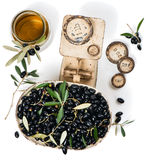 Balance scale fresh of olives and olive oil; top view Royalty Free Stock Photos