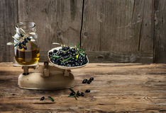 Balance scale fresh olives and olive oil Stock Image