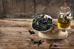 Balance scale fresh olives and olive oil Stock Images