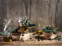Balance scale fresh olives and olive oil Royalty Free Stock Image