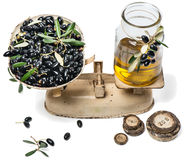 Balance scale  fresh olives and olive oil Stock Photography