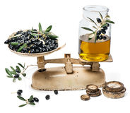 Balance scale fresh of olives and olive oil Royalty Free Stock Images