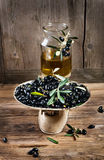 Balance scale  fresh olives and olive oil Stock Photo