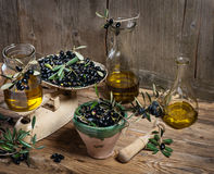 Balance scale  fresh olives and olive oil Royalty Free Stock Images