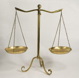 Balance scales. Brass balance scales.  simple and efficient, now a decoration for the home Stock Photos