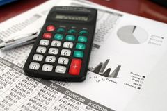 Balance Sheet. Calculator over balance sheets with numbers and graphs and a pen Royalty Free Stock Images