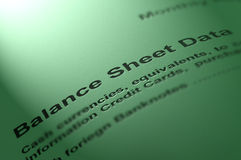 Balance sheet data. Monthly balance sheet report on textured paper royalty free stock photo