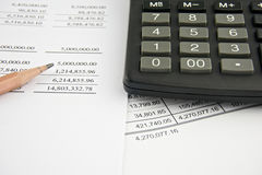 Balance sheet with pencil and black calculator Royalty Free Stock Photo
