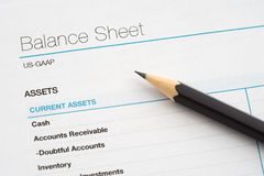 Balance sheet. Report and pencil stock photography