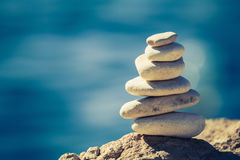 Balance spa wellness concept. Balance and wellness retro spa concept, inspiration, zen-like and well being tranquil composition. Close-up of white pebbles stack stock photo