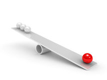 Balance of spheres on a board Stock Images