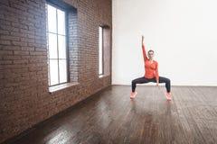 Balance squat. Hard gymnastics poses. Studio shot Royalty Free Stock Photo