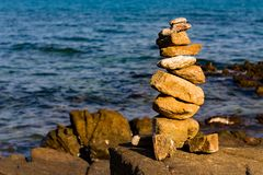 Balance stack stone on seacoast. Abstract background stock photo