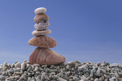 Balance stone on pile rock with blue sky background. Balance stone on pile rock with blue sky background for concept of Zen and calm Stock Photography