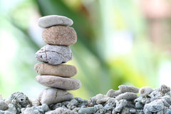 Balance stone on pile rock with garden background. Balance stone on pile rock with garden background for concept of Zen and spa Royalty Free Stock Photo