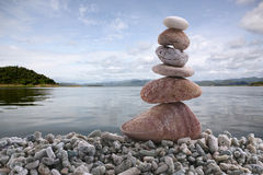 Balance stone on pile rock with river background. Balance stone on pile rock with river background for concept of Zen and calm Stock Photography