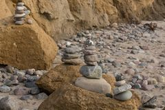 Balance stone with spa on the river or coast. Stones stacked on top of each other on the beach in the background the cliff royalty free stock photos