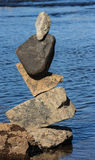 Balance of Stones. OTTAWA, CANADA – AUGUST 18: A pile of balanced stones at the International Stone Balance Festival at Remic Rapids and the Ottawa River on Stock Image