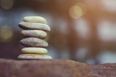 Balance stones on abstract bokeh with copy space for spa concept royalty free stock photos