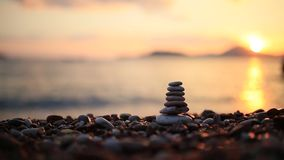 Balance stones on the beach. Peace of mind. Equilibrium life. Ca. Lming nerves stock video