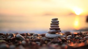 Balance stones on the beach. Peace of mind. Equilibrium life. Ca. Lming nerves stock footage